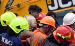 Rescue workers carry Mohammed Bangi, a four-year-old boy, after he was rescued from the rubble at the site of a collapsed five-storey building in Mahad in Raigad district in the western state of Maharashtra, India, August 25, 2020. REUTERS/Stringer NO ARCHIVES. NO RESALES.