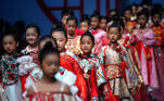Child models present creations from the MIBAI Spring/Summer 2021 collection show by Qingmei Lou, during China Fashion Week in Beijing October 26, 2020. REUTERS/Tingshu Wang