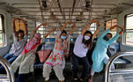 Women perform yoga in a local train on the occasion of International Yoga Day, amid the ongoing coronavirus disease (COVID-19) pandemic, in Mumbai, India, June 21, 2021. REUTERS/Niharika Kulkarni
