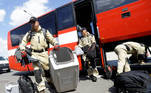 Members of Urban Search and Rescue (USAR) team leave a bus before boarding an airplane as they depart the Vaclav Havel Airport to Beirut in Prague, Czech Republic, August 5, 2020. REUTERS/David W Cerny