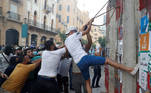 Demonstrators try to break a barrier during a protest in Beirut, Lebanon, August 10, 2020. REUTERS/Goran Tomasevic