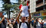 A man shouts slogans in front of the former U.S. Consulate General in Chengdu, Sichuan province, China, July 27, 2020, after China ordered its closure in response to U.S. order for China to shut its consulate in Houston. REUTERS/Thomas Peter