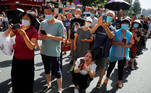 People gather near the U.S. Consulate General in Chengdu, Sichuan province, China, July 27, 2020, as the final group of U.S. personnel from the consulate is expected to leave after China ordered its closure in response to a U.S. order for China to shut its consulate in Houston. REUTERS/Thomas Peter