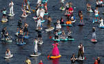 Participants make their way on the Fontanka river during the Fontanka-SUP stand up paddle boarding festival in Saint Petersburg, Russia August 8, 2020. REUTERS/Anton Vaganov