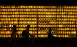 Visitors are seen in front of thousands paper lanterns during the Mitama Festival at the Yasukuni Shrine, where more than 2.4 million war-dead are enshrined, during a fourth coronavirus state of emergency for the Tokyo capital ahead of the opening of Tokyo 2020 Olympic Games in Tokyo, Japan July 13, 2021. REUTERS/Issei Kato