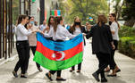 People take part in celebrations in a street following the signing of a deal to end the military conflict over the Nagorno-Karabakh region in Baku, Azerbaijan November 10, 2020. REUTERS/Stringer NO RESALES. NO ARCHIVES.