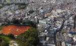 "A view shows people standing to receive food aid distributed by the ""G10 das Favelas"", a group of slum's entrepreneurs, amid the coronavirus disease (COVID-19) pandemic at Heliopolis slum in Sao Paulo, Brazil April 14, 2021. Picture taken with a drone. REUTERS/Leonardo Benassatto NO RESALES. NO ARCHIVES"