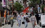 """Maki, Mayu, Koiku and Ikuko, who are geisha, wear protective face masks as they walk to a restaurant after attending a dance class, during the coronavirus disease (COVID-19) outbreak, in Tokyo, Japan. July 13, 2020. Ikuko fears an extended pandemic could prompt some geisha to quit. """"Now is the worst of the worst"""", she said. """"How are we going to get through? It'll take all of our body and soul."""" REUTERS/Kim Kyung-Hoon SEARCH """"GEISHA COVID-19"""" FOR THIS STORY. SEARCH """"WIDER IMAGE"""" FOR ALL STORIES."""