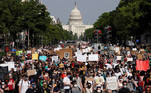 SENSITIVE MATERIAL. THIS IMAGE MAY OFFEND OR DISTURB The U.S. Capitol is seen in the background as protesters march during a rally against the death in Minneapolis police custody of George Floyd, in Washington, U.S., June 3, 2020. REUTERS/Joshua Roberts