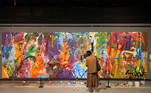A visitor looks at the graffiti artwork of New York-based artist Jon One which was damaged by young couple at a gallery in Seoul, South Korea April 2, 2021. REUTERS/Minwoo Park