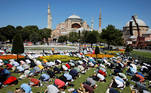 Muslims attend Friday prayers outside Hagia Sophia Grand Mosque, for the first time after it was once again declared a mosque after 86 years, in Istanbul, Turkey, July 24, 2020. REUTERS/Umit Bektas
