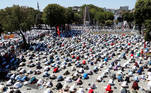 Muslims attend Friday prayers outside Hagia Sophia Grand Mosque, for the first time after it was once again declared a mosque after 86 years, in Istanbul, Turkey, July 24, 2020. REUTERS/Murad Sezer