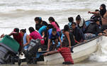 Venezuelan migrants, who were recently deported, arrive at shore on Los Iros Beach after their return to the island, in Erin, Trinidad and Tobago, November 24, 2020. Lincoln Holder/Courtesy Newsday/Handout via REUTERS THIS IMAGE HAS BEEN SUPPLIED BY A THIRD PARTY. THIS PICTURE WAS PROCESSED BY REUTERS TO ENHANCE QUALITY.
