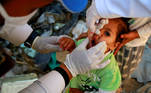 A girl receives a polio vaccine during a three-day immunization campaign in Sanaa, Yemen November 29, 2020. REUTERS/Nusaibah Almuaalemi TPX IMAGES OF THE DAY