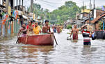 People wade through a flooded street to collect food and drinking water from a distribution centre in Amta town of Howrah district in the eastern state of West Bengal, India, August 5, 2021. REUTERS/Stringer NO ARCHIVES. NO RESALES. TPX IMAGES OF THE DAY