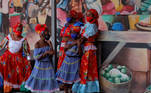 Traditional Haitian dancers look on as Democratic U.S. presidential nominee Joe Biden speaks during a campaign stop at Little Haiti Cultural Complex in Miami, Florida, U.S., October 5, 2020. REUTERS/Brendan McDermid
