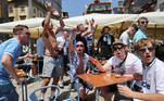 Soccer Football - Champions League - Fans in Porto ahead of the Champions League Final Manchester City v Chelsea - Porto, Portugal - May 29, 2021 Manchester City fans drink outside a bar in Porto ahead of the match REUTERS/Carl Recine