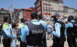 Soccer Football - Champions League - Fans in Porto ahead of the Champions League Final Manchester City v Chelsea - Porto, Portugal - May 29, 2021 Police officers watch over fans who have gathered in Porto ahead of the match REUTERS/Carl Recine