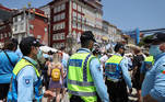 Soccer Football - Champions League - Fans in Porto ahead of the Champions League Final Manchester City v Chelsea - Porto, Portugal - May 29, 2021 Police officers walk through a crowd of fans who have gathered in Porto ahead of the match REUTERS/Carl Recine