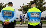 Soccer Football - Champions League - Fans in Porto ahead of the Champions League Final Manchester City v Chelsea - Porto, Portugal - May 29, 2021 Police look on as Chelsea fans arrive in Porto ahead of the match REUTERS/Violeta Santos Moura