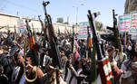 Houthi supporters hold up their weapons during a demonstration against the United States decision to designate the Houthis as a foreign terrorist organisation, in Sanaa, Yemen January 20, 2021. REUTERS/Khaled Abdullah