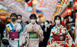 Women in traditional costumes walk beneath decorations for the upcoming new year, amid the coronavirus disease (COVID-19) outbreak in Tokyo, Japan December 18, 2020. REUTERS/Kim Kyung-Hoon