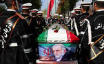 Members of Iranian forces carry the coffin of Iranian nuclear scientist Mohsen Fakhrizadeh during a funeral ceremony in Tehran, Iran November 30, 2020. Iranian Defense Ministry/ WANA (West Asia News Agency)/Handout via REUTERS ATTENTION EDITORS - THIS IMAGE HAS BEEN SUPPLIED BY A THIRD PARTY. TPX IMAGES OF THE DAY
