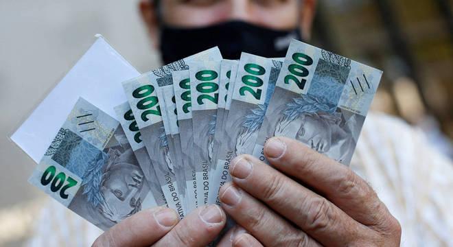 Auxílio residual irá pagar de R$ 300 a R$ 600 em quatro parcelas até dezembro