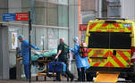 Medics transport a patient from an ambulance to the Royal London Hospital as the spread of the coronavirus disease (COVID-19) continues in London, Britain, January 1, 2021. REUTERS/Hannah McKay