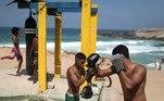 The coronavirus disease (COVID-19) outbreak in Rio de Janeiro Men practice boxing in Arpoador beach, amid the outbreak of the coronavirus disease (COVID-19), in Rio de Janeiro, Brazil September 13, 2020. REUTERS/