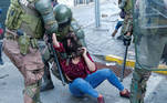 A demonstrator is detained by riot police during a protest against Chile's government in Valparaiso, Chile. October 19, 2020. REUTERS/Rodrigo Garrido
