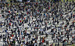 A general view taken from a wheel shows people gathering during a protest against the government's restrictions, amid the coronavirus disease (COVID-19) outbreak, in Konstanz, Germany October 4, 2020. REUTERS/Arnd Wiegmann