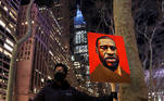 A demonstrator holds up an image of George Floyd during a rally on the first day of the trial of former Minneapolis police officer Derek Chauvin, on murder charges in the death of Floyd, in New York City, New York, U.S., March 8, 2021. REUTERS/Shannon Stapleton TPX IMAGES OF THE DAY