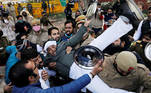 Police officers detain an activist of the youth wing of India's main opposition Congress party during a protest against new farm laws in New Delhi, India January 12, 2021. REUTERS/Adnan Abidi TPX IMAGES OF THE DAY