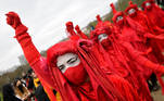 Demonstrators wearing costumes protest in London, Britain, April 3, 2021. REUTERS/Toby Melville