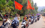 Demonstrators display signs and flags in a motorcycle procession against the ongoing coup, from Nyinmaw to Tizit, Myanmar March 17, 2021 in this still image obtained from social media video. Dawei Watch via REUTERS THIS IMAGE HAS BEEN SUPPLIED BY A THIRD PARTY. MANDATORY CREDIT. NO RESALES. NO ARCHIVES
