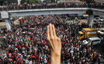 A demonstrator shows the three-finger salute as people rally in a protest against the military coup and to demand the release of elected leader Aung San Suu Kyi, in Yangon, Myanmar, February 7, 2021. REUTERS/Stringer NO RESALES. NO ARCHIVES