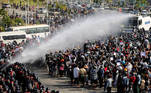 Police fire a water cannon at protesters demonstrating against the coup and demanding the release of elected leader Aung San Suu Kyi, in Naypyitaw, Myanmar, February 8, 2021. REUTERS/Stringer NO RESALES. NO ARCHIVES. TPX IMAGES OF THE DAY