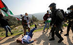 A Palestinian demonstrator falls on the ground after being knocked down by Israeli forces during a protest against Jewish settlements in Salfit in the Israeli-occupied West Bank December 3, 2020. REUTERS/Mohamad Torokman TPX IMAGES OF THE DAY
