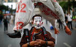 A pro-democracy protester with a painted face participates in a rally demanding the release of arrested protest leaders and the abolition of 112 lese majeste law, in Bangkok, Thailand, March 24, 2021. REUTERS/Jorge Silva TPX IMAGES OF THE DAY