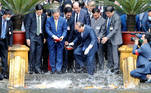 Japanese Prime Minister Yoshihide Suga and his Vietnamese counterpart Nguyen Xuan Phuc feed the fish by a pond at the Presidential Palace compound in Hanoi, Vietnam, October 19, 2020. Minh Hoang/Pool via REUTERS