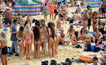 Youth enjoy the sunny weather at the Bournemouth Beach, amid the coronavirus disease (COVID-19) outbreak, in Bournemouth, Britain July 31, 2020. REUTERS/Toby Melville