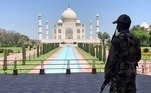 A member of Central Industrial Security Force (CISF) personnel stands guard inside the empty premises of the historic Taj Mahal during a 21-day nationwide lockdown to slow the spread of COVID-19, in Agra, India, April 2, 2020. REUTERS/Sunil Kataria/File Photo