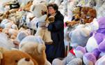 "Valeria Schmidt, nicknamed as ""Teddy Bear Mama"", hugs a teddy bear in Harsany, Hungary, January 11, 2021. Picture taken January 11, 2021. REUTERS/Bernadett Szabo"