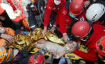 Rescue workers carry a 4-year-old girl, Ayda Gezgin, out from a collapsed building after an earthquake in the Aegean port city of Izmir, Turkey November 3, 2020. Turkey's Disaster and Emergency Management Presidency (AFAD)/Handout via REUTERS ATTENTION EDITORS - THIS PICTURE WAS PROVIDED BY A THIRD PARTY. NO RESALES. NO ARCHIVE. REFILE - CORRECTING GIRL'S NAME TPX IMAGES OF THE DAY