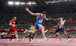 Tokyo 2020 Olympics - Athletics - Men's 4 x 100m Relay - Final - Olympic Stadium, Tokyo, Japan - August 6, 2021. Filippo Tortu of Italy crosses the line to win gold REUTERS/Pawel Kopczynski TPX IMAGES OF THE DAY