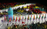 Tokyo 2020 Paralympic Games - The Tokyo 2020 Paralympic Games Closing Ceremony - Olympic Stadium, Tokyo, Japan - September 5, 2021. Volunteers hold national flags during the parade at the closing ceremony REUTERS/Kim Kyung-Hoon