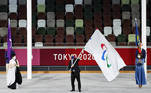 Tokyo 2020 Paralympic Games - The Tokyo 2020 Paralympic Games Closing Ceremony - Olympic Stadium, Tokyo, Japan - September 5, 2021. International Paralympic Committee President Andrew Parsons waves the Paralympic flag next to Tokyo Governor Yuriko Koike and Mayor of Paris Anne Hidalgo for the handover ceremony during closing ceremony. REUTERS/Kim Kyung-Hoon