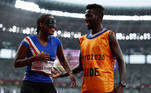 Tokyo 2020 Paralympic Games - Athletics - Women's 200m - T11 Round 1 - Heat 4 - Olympic Stadium, Tokyo, Japan - September 2, 2021. Keula Nidreia Pereira Semedo of Cape Verde and guide Manuel Antonio Vaz da Veiga smile after he proposed to her after competing REUTERS/Athit Perawongmetha