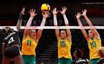 Tokyo 2020 Olympics - Volleyball - Women's Pool A - Brazil v Kenya - Ariake Arena, Tokyo, Japan - August 2, 2021. Leonida Kasaya of Kenya in action with Tandara of Brazil, Carol of Brazil and Gabi of Brazil. REUTERS/Valentyn Ogirenko